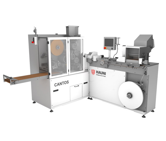 "Picture of the white-silver Hauni machine ""CANTOS"" which is used for semi-industrial environment pre-roll production."